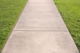 Sidewalk and grass converging lines