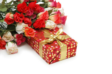 roses and gift box isolated on white