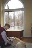 man and his dog in the living room flood in backya poster