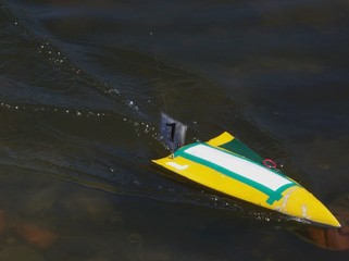 finish of yellow motor boat