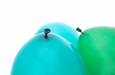 one green and two blue balloons