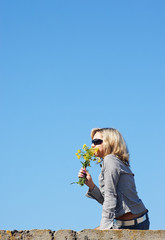 girl sniffing flowers