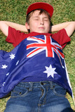 patriotic boy with flag draped over him poster