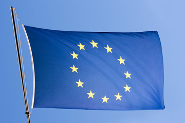 european eu flag on a blue sky close-up