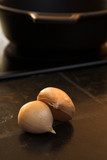 cloves of garlic lying on a kitchen counter poster