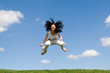 jumping girl in meadow