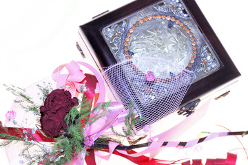 dry rose and jewelery box