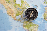 magnetic compass and world map poster