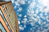 apartments building and cloudy sky poster