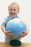laughing child with globe poster