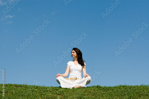 girl meditation in green grass