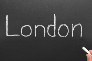 London, written on a blackboard.