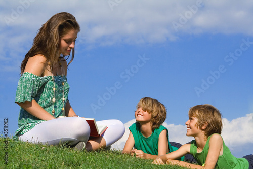 happy christian family reading bible