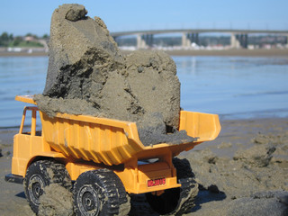 toy dump truck at the beach
