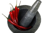 granite mortar and pestle with red chillies poster