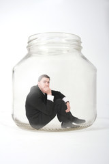 businessman  in the jar