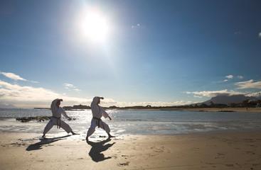 Man practicing Karate on the beach