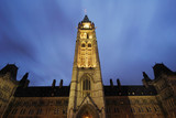 cloud trails over canada's parliament building poster