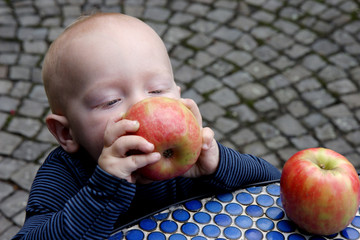 little boy and apples