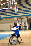 basketball player in wheelchair with ball in action poster