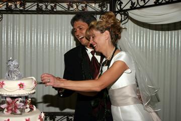 Bridal Couple Cutting Cake