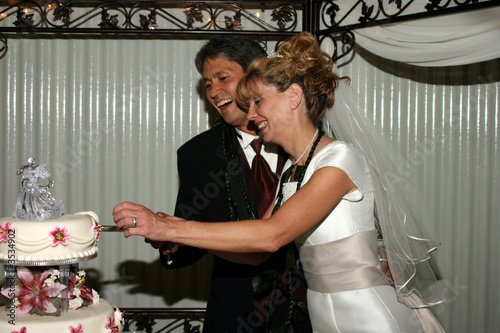 Bridal Couple Cutting Cake