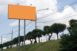 orange billboard on the street under blue sky and clouds poster
