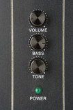 faders volume bass tone and power lamp poster
