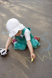 baby drawing chalk on asphalt lettesr ma poster