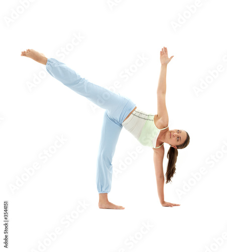 sporty girl practicing ardha chandrasana half moon pose