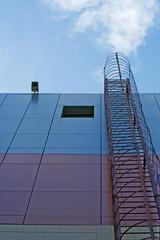 Fire-escape and urbanistic scene of modern city architecture.