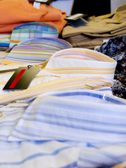 A close up on mens shirts in a store.