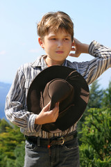 Outback boy in magnificent high country, rustling hair