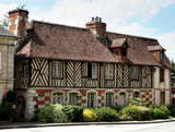 Timber Framed House in an Historic Village in Normandy, France poster
