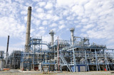 oil refinery and blue sky poster