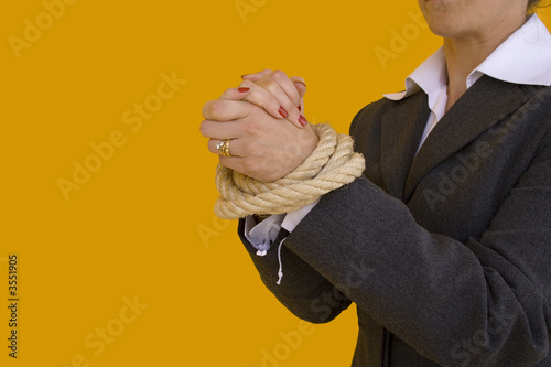 a business woman with her hands tied for a corporate crime
