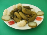 Appetizer. Preserves. Plate of mixed pickles/pickle.  poster