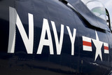 US Navy markings on the side of a restored vintage aircraft. poster