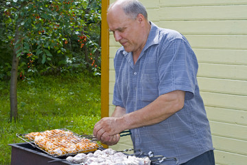 The grandfather does a shish kebab