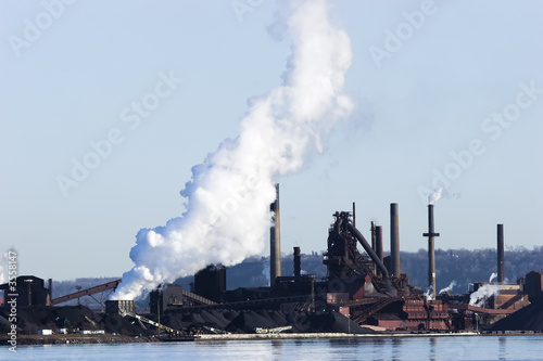 Photo: Iron ore smelting plant on the shores of a lake. © Wally ...