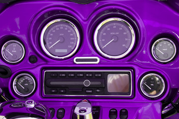 Close-up view of bright purple motorcycle dashboard