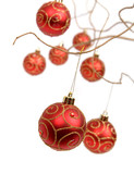 Red christmas baubles hanging from golden curly branches poster
