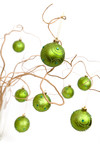 Green christmas baubles hanging from golden curly branches poster