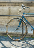 Old bicycle in the street of Rome poster