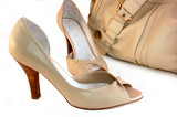 beige shoes and handbag isolated on white poster