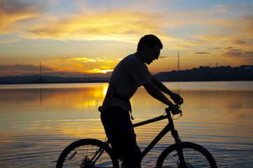 biker whith sunset at the background