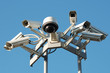 Leinwanddruck Bild - Security cameras mounting on the high top position