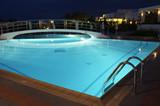 Night illumination in the swimming pool in resort poster