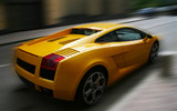 Yellow respectable automobile on a dim background poster