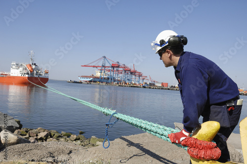 container ship and dock- worker